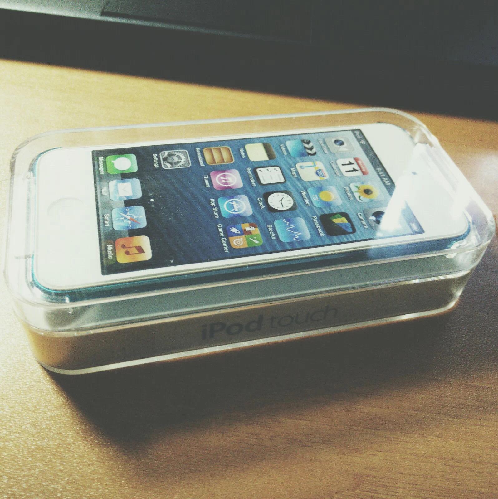 卖出 iPod touch 5 前留影